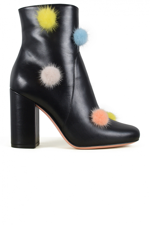 Luxury shoes for women - Fendi boots in black leather with pompoms