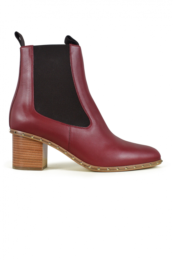 Luxury shoes for women - Valentino Rockstud boots in red/pink leather
