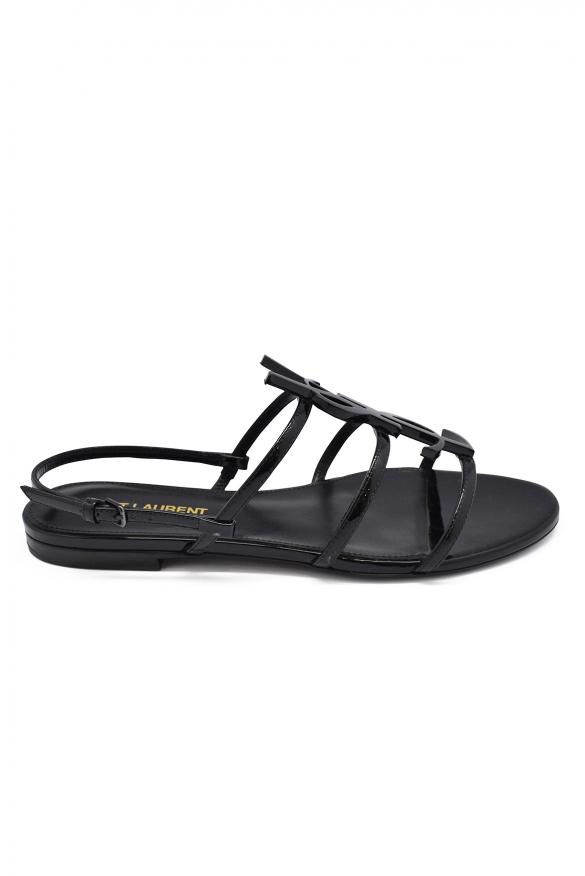 Luxury shoes for women - Saint Laurent Cassandra black leather flat sandals