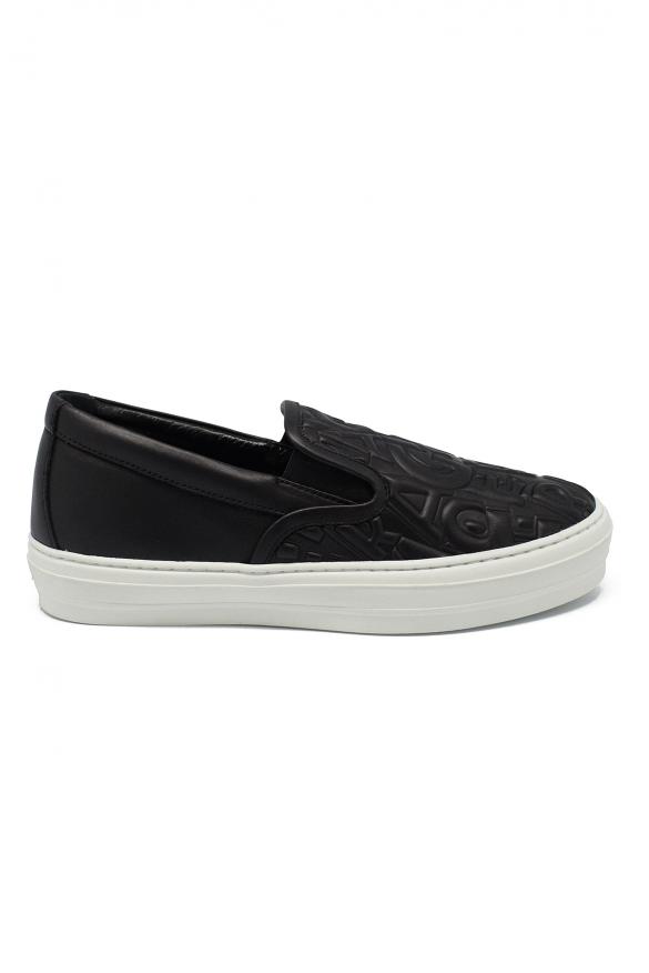 Luxury shoes for women - Salvatore Ferragamo slip-on in black leather